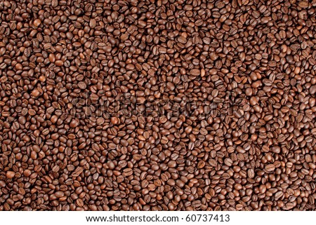 Coffee beans (Arabica and robusta mixture) roasted background.