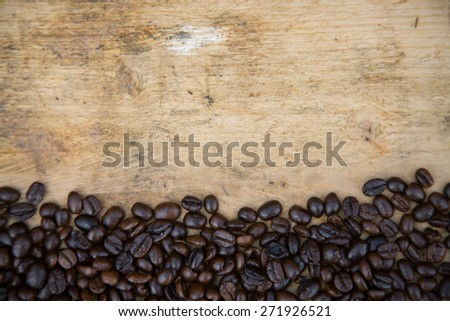 Coffee beans background on wooden, Fresh coffee beans with coffee cup on wooden background, Drinking set background.