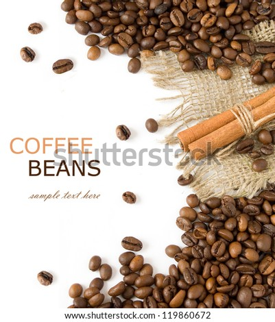Coffee beans background with cinnamon and sacking material isolated on white with sample text
