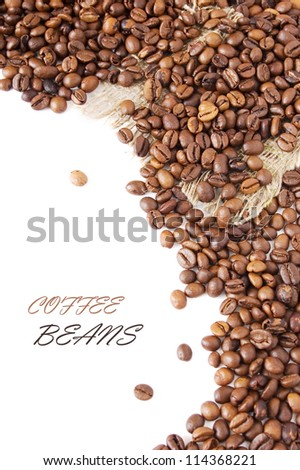 Coffee beans background with sacking material isolated on white with sample text
