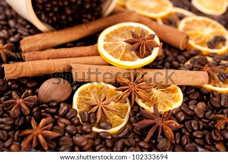 Coffee beans, cinnamon sticks, star anise and nutmeg. Background.