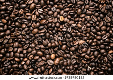 Coffee beans. Coffee beans are spread out on the surface.