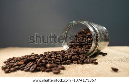 coffee beans, coffee beans in a jar, spilled coffee beans.Coffee beans on the sack.