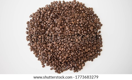 Coffee beans collected on a white background,close-up,top view.