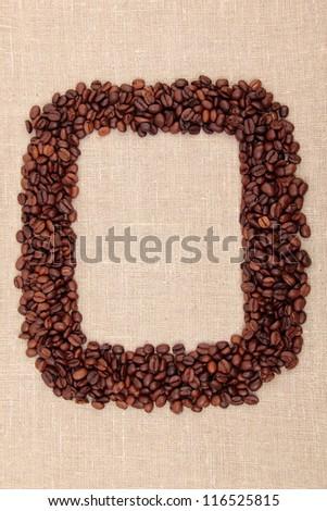Coffee beans frame over light  brown linen texture