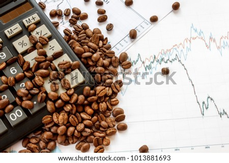 Coffee beans futures chart. Fresh coffee lies on graphics of quotations and the calculator. Top view