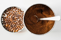 coffee beans ground coffee powder mixture in a jar with a spoon isolated on white background concept cafe shop site