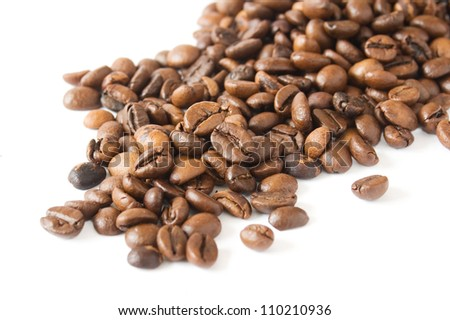 Coffee beans handful closeup isolated on white background
