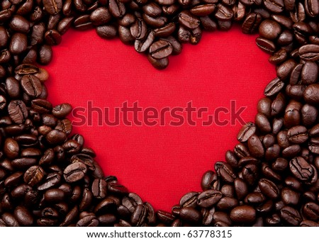 Coffee beans heart on red background