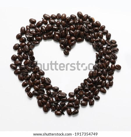Coffee Beans.  I love coffee.  Heart shaped coffee beans.  Dark black roasted espresso coffee.  For latte, cappuccino, mocha, caffe americano, macchiato, robusta.  stock photo