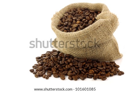 coffee beans in a burlap bag on a white background