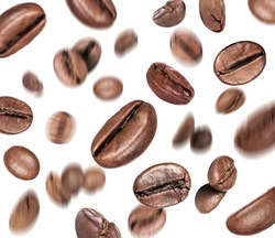 Coffee beans in a chaotic position in space, isolated on a white background