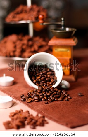 Coffee beans in a cup, blurred surrounding