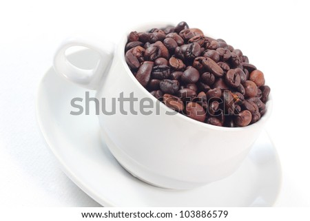 coffee beans in a cup on white background