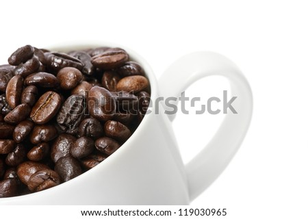 Coffee beans in a cup on white isolated.