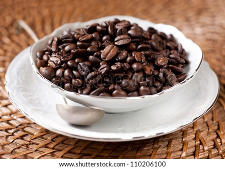 Coffee beans in a white cup