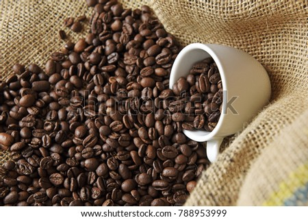 Coffee beans in coffee cup #788953999