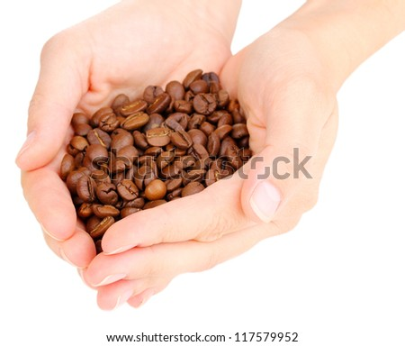 Coffee beans in hands isolated on white