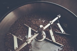 coffee beans in roast machine, arabica roasted coffee  ,color vintage style. Thailand