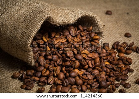Coffee beans in sack,  burlap background