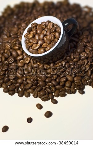 Coffee beans in the cup. Close up