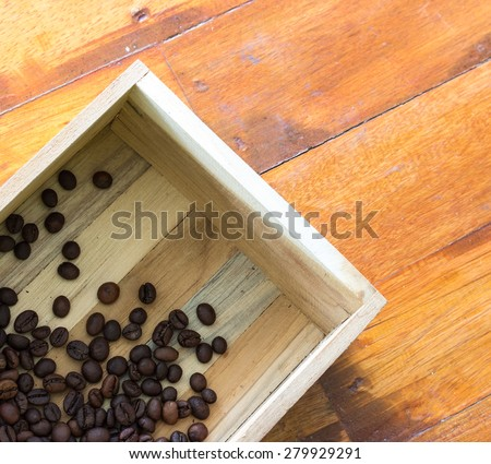 coffee beans in wood box on wood