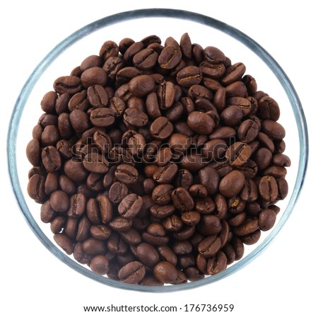 Coffee beans inside glass jug on white background