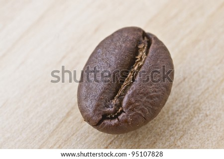 Coffee beans isolated in wood background with great details