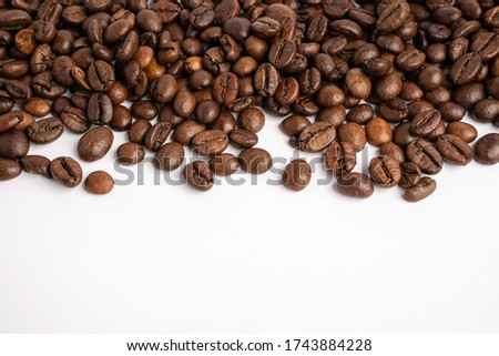Photo of Coffee beans laid together There is free space at the bottom of the image. White background