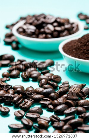 Coffee beans on blue background.