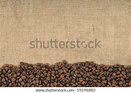 Coffee beans on brown jute background