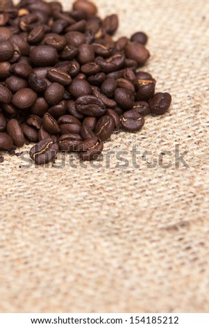 Coffee beans on burlap sack. Food and drink coffee background.