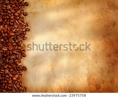 Coffee beans on old parchment paper - stock photo
