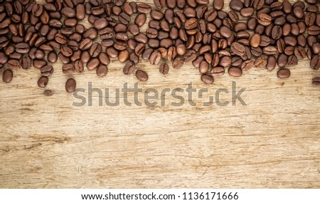 Coffee beans on old wood background