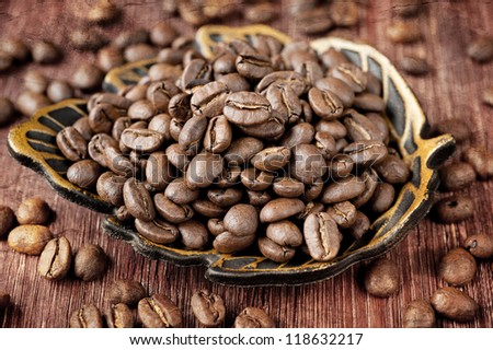 Coffee beans on old wooden board