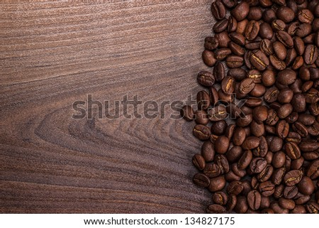 coffee beans on the brown wooden background