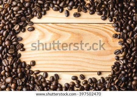 Photo of Coffee beans on the table. Free space for your text