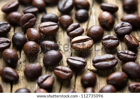 Coffee beans on the vintage wooden table