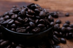 coffee beans on wood table and macro coffee beans background