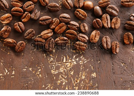 Coffee beans on wooden background, close-up #238890688