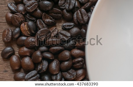 Coffee beans on wooden desk background. #437683390