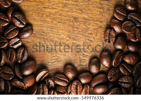 Coffee beans on wooden table close up #549976336