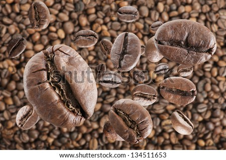 coffee beans rain on coffee beans background