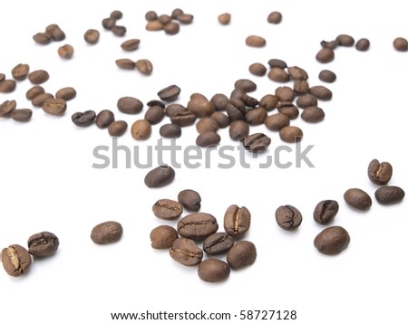 Coffee beans scattered, isolated on white.