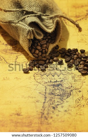 coffee beans scattered on an old map of South America