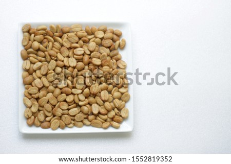 Coffee beans, shell, white plate,background