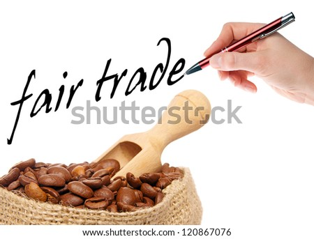 coffee beans with hand writes fair trade / fair trade coffee