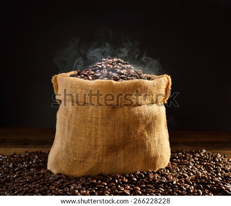 Coffee beans with smoke in burlap sack, This photo is available without smoke