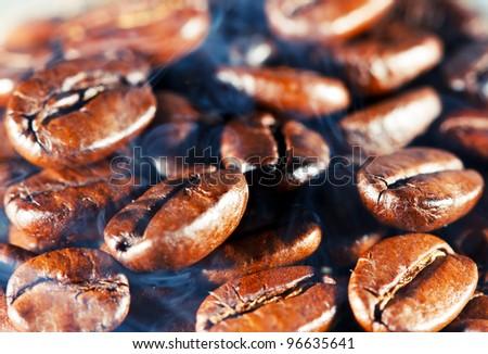 Coffee beans with smoke. Macro.