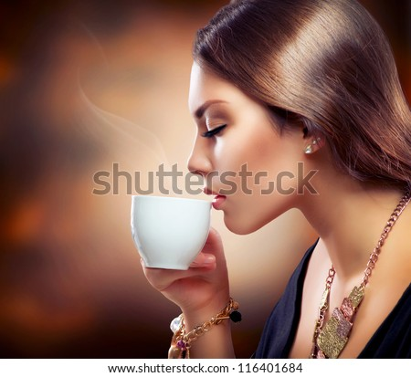 Coffee Beautiful Girl Drinking Tea or Coffee Cup of Hot Beverage